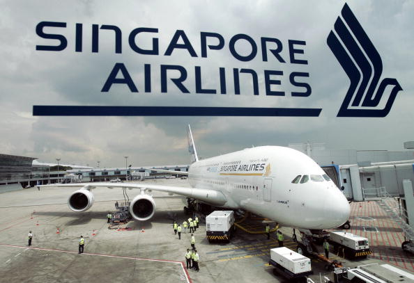 SINGAPORE, SINGAPORE: This file photo taken on the 11 November 2005, shows a prototype Airbus A380 parked at the Singapore Changi Airport terminal during its first long-range test flight outside europe. Airbus will display the world's largest commercial aircraft, the A380, in Singapore Airlines (SIA) colours at the Asian Aerospace show here next month, the carrier said. AFP PHOTO/ROSLAN RAHMAN (Photo credit should read ROSLAN RAHMAN/AFP/Getty Images)