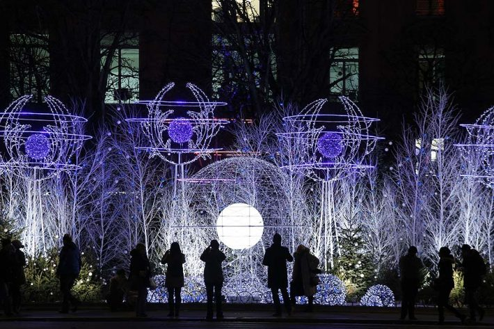 Christmas decorations light up the Champs Elysees avenue in Paris, Monday, Dec. 2, 2013. The decorations are traditionally put up late November each year for Christmas. (AP Photo/Christophe Ena) ** Usable by LA and DC Only **